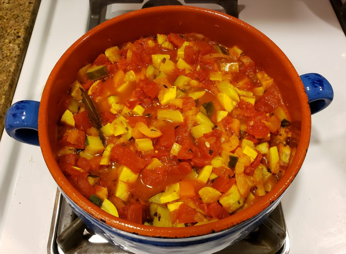 Pot of ratatouille simmering on the stove.