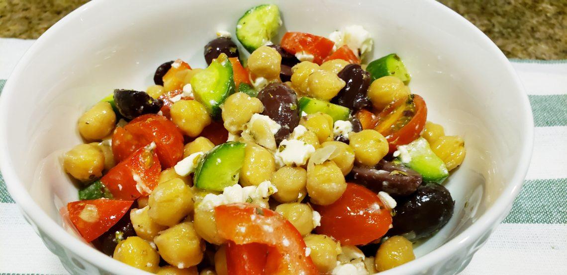 Garbanzo been salad with fresh veggies and Feta cheese.