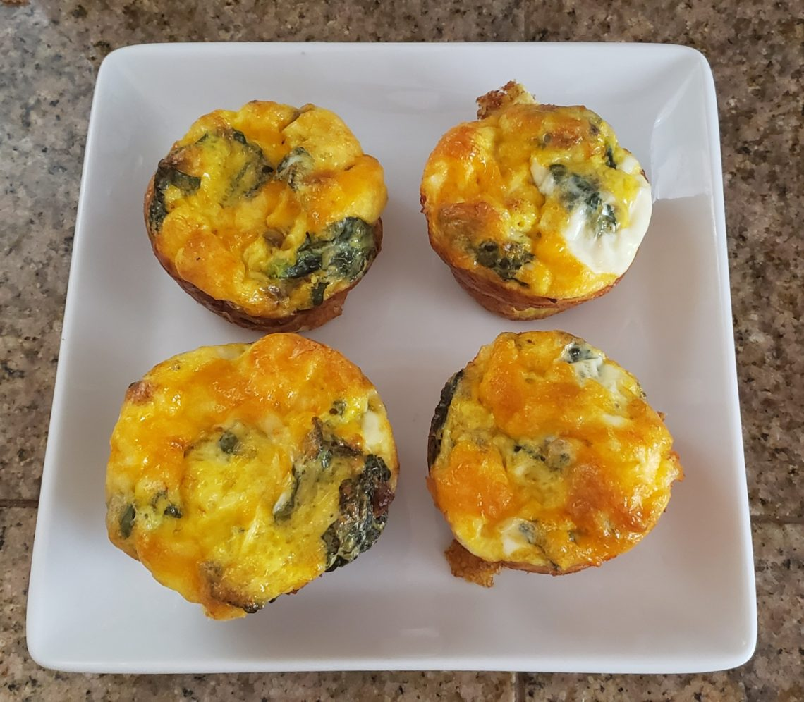 Four cooked egg muffins.